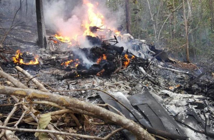 Scene from a plane crash in Costa Rica that killed 10 US citizens, December 2017 (photo credit: MINISTERIO DE SEGURIDAD PUBLICA DE COSTA RICA VIA REUTERS)