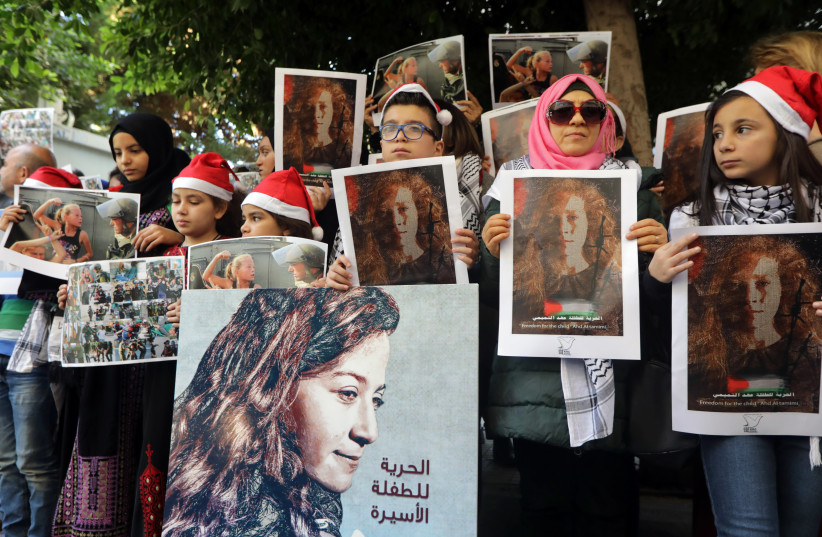 Lebanese and Palestinians gather for a protest calling for the release of Palestinian teen Ahed Tamimi (photo credit: ANWAR AMRO / AFP)