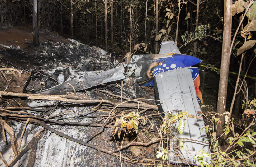 he tail of the burned fuselage of a small plane that crashed is seen in Guanacaste, Corozalito, Costa Rica on December 31, 2017 (photo credit: EZEQUIEL BECERRA / AFP)