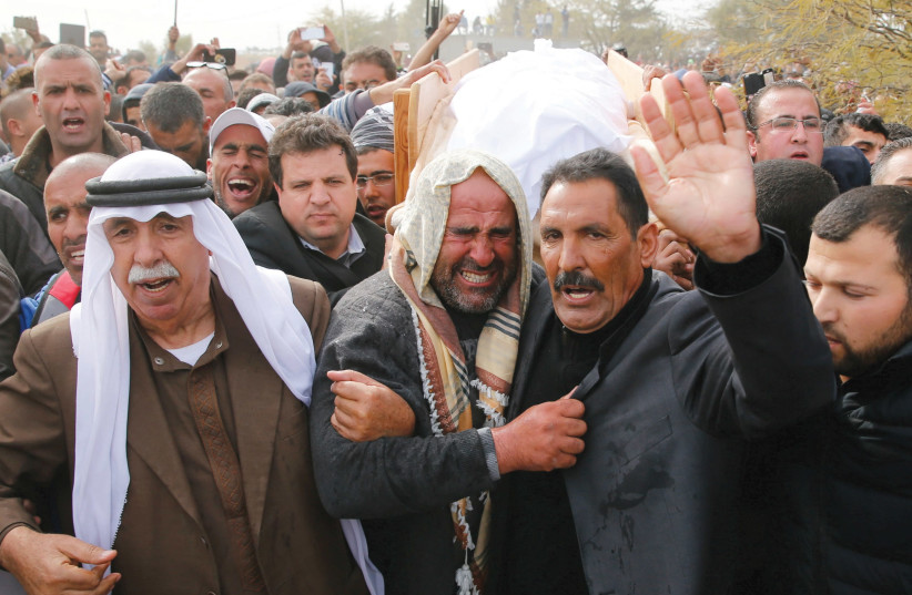 FRIENDS AND RELATIVES carry the body of Ya'qoub Abu al-Qi'an during his funeral in the Beduin village of Umm al-Hiran in the Negev. (photo credit: AMMAR AWAD / REUTERS)