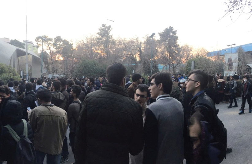 PROTESTERS ARE SHOWN near the University of Tehran on Saturday in a photo obtained from social media. (photo credit: REUTERS)