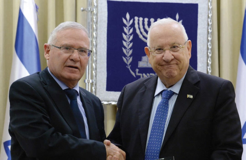 INSS EXECUTIVE DIRECTOR Amos Yadlin (left) presents a copy of the think tank's annual assessment of the region to President Reuven Rivlin yesterday at the President's Residence in Jerusalem (photo credit: Mark Neiman/GPO)