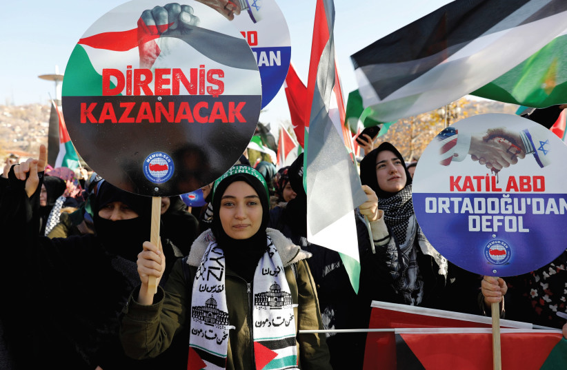DEMONSTRATORS HOLD BANNERS and Turkish and Palestinian flags as they shout slogans during a protest against US President Donald Trump's recognition of Jerusalem as Israel's capital, after Friday prayers at Haci Bayram Mosque in Ankara, in December. (photo credit: REUTERS)
