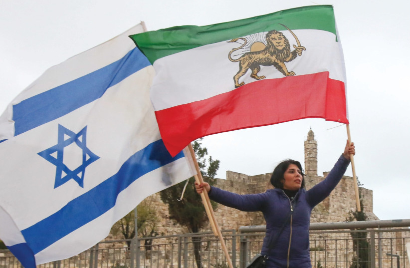 Blogger Neda Amin leads a protest against the Iranian regime outside the Old City, January 2018 (photo credit: MARC ISRAEL SELLEM/THE JERUSALEM POST)