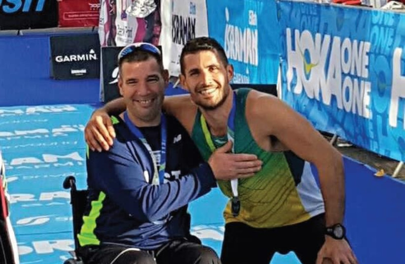 Avi De-Pilosof (left) will be making his return to true competition on Friday when he participates in the Tiberias marathon in his new racing wheelchair. (photo credit: Courtesy)