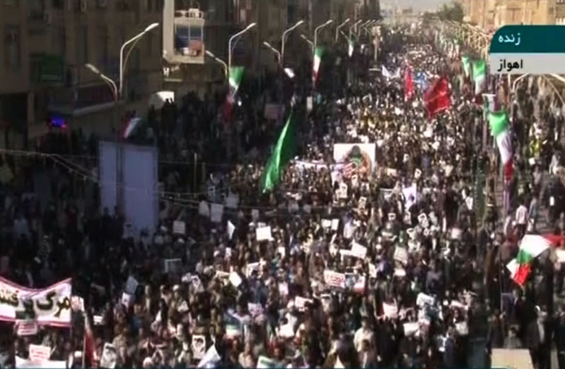 A image grab from the Islamic Republic of Iran News Network (IRINN) state television channel shows pro-government demonstrators in the city of Ahvaz in southwestern Iran (photo credit: AFP PHOTO / HO / IRINN)