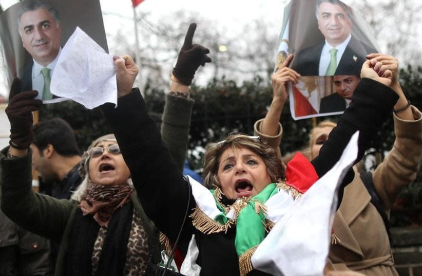 Opponents of Iranian President Hassan Rouhani hold a protest outside the Iranian embassy in west London, Britain, January 2, 2018 (photo credit: REUTERS/SIMON DAWSON)