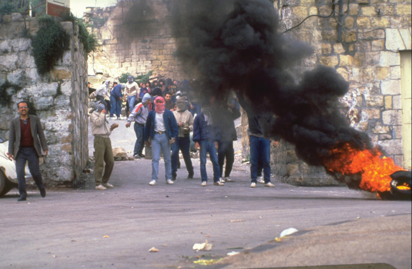 PALESTINIANS BURN tires in a demonstration during the First Intifada in Ramallah in 1988 (photo credit: GPO)