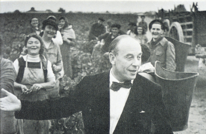 A young Baron Philippe de Rothschild in the vines (photo credit: Courtesy)
