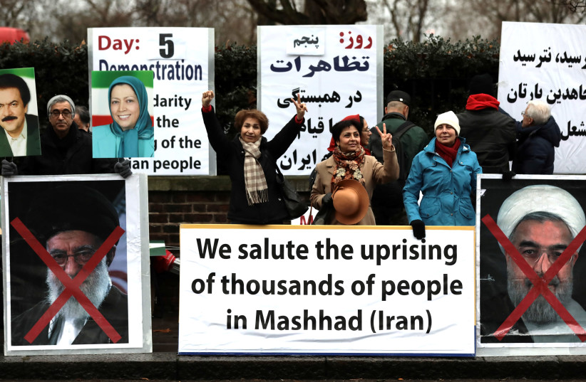 Opponents of Iranian President Hassan Rouhani hold a protest outside the Iranian embassy in west London, Britain, January 2, 2018. (photo credit: SIMON DAWSON/ REUTERS)