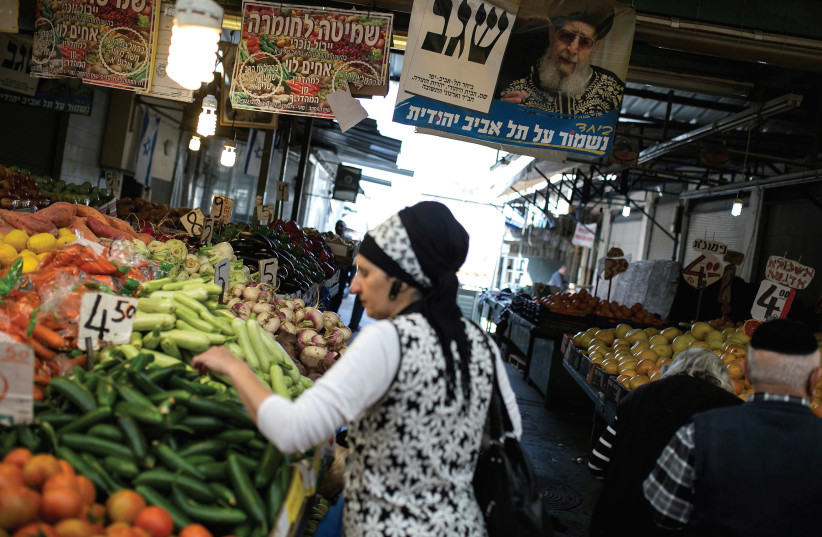 A WOMAN shops for vegetables at the Carmel market in Tel Aviv. (photo credit: REUTERS)