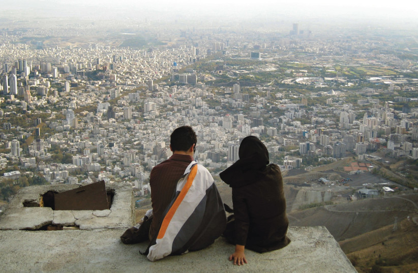 AN IRANIAN couple looks out over the city of Tehran. (photo credit: REUTERS)