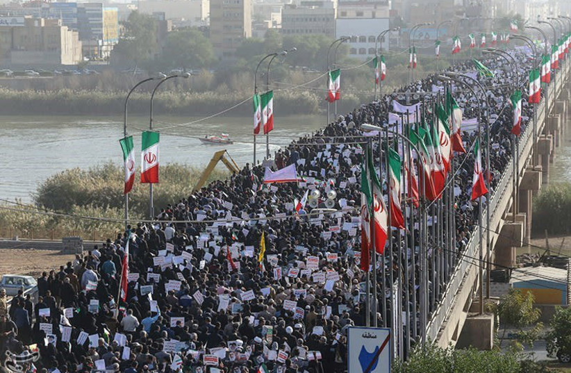 People take part in pro-government rallies, Iran, January 3, 2018. (photo credit: TASNIM NEWS AGENCY/HANDOUT VIA REUTERS)