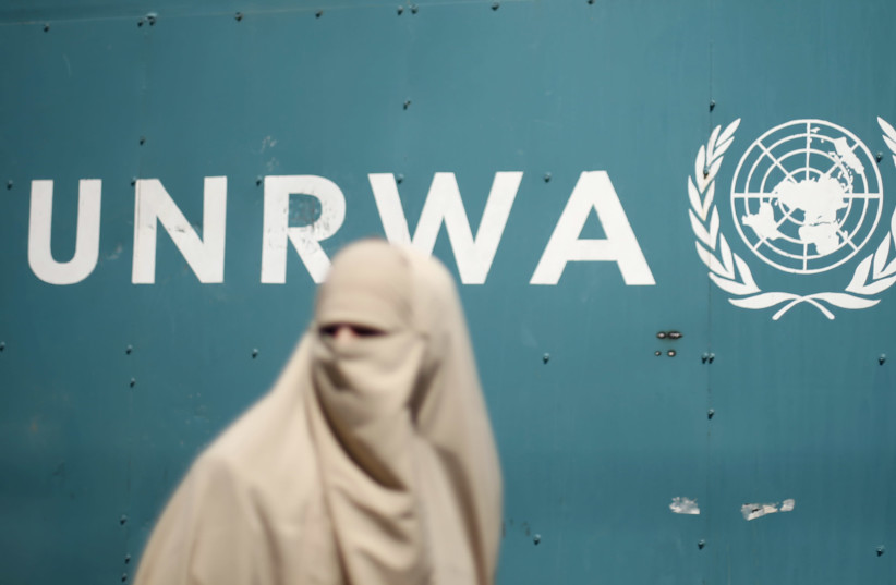 A Palestinian woman takes part in a protest against possible reductions of the services and aid offered by United Nations Relief and Works Agency (UNRWA), in front of UNRWA headquarters in Gaza City August 16, 2015. (photo credit: REUTERS/MOHAMMED SALEM)