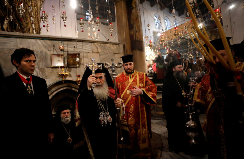 The Greek Orthodox Patriarch of Jerusalem Theophilos III attends a Christmas service according to the Eastern Orthodox calendar, in the church of Nativity in the West Bank city of Bethlehem. (photo credit: REUTERS)