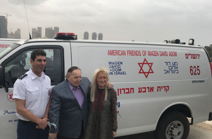Sheldon and Miri Adelson at the dedication ceremony of new ambulances they donated to Magen David Adom. (photo credit: MAGEN DAVID ADOM)