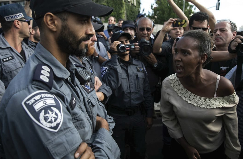 AN ETHIOPIAN PROTESTER shouts at a policeman during a demonstration in Tel Aviv against what protesters say is police racism and brutality. (photo credit: BAZ RATNER/REUTERS)