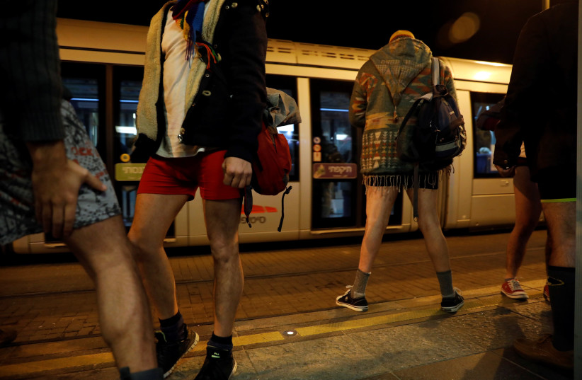 Israelis take part in the annual No Pants Day on Jerusalem's Light Rail, January 2018 (photo credit: RONEN ZVULUN/ REURERS)