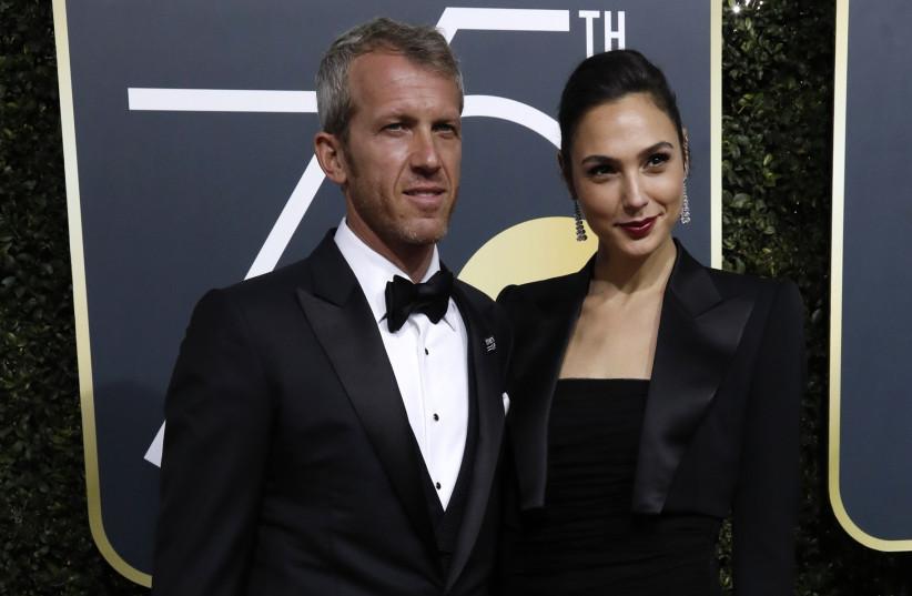 Actress Gal Gadot and her husband, Yaron Versano, at the 75th Golden Globe Awards on January 7, 2018. (photo credit: REUTERS/MARIO ANZUONI)