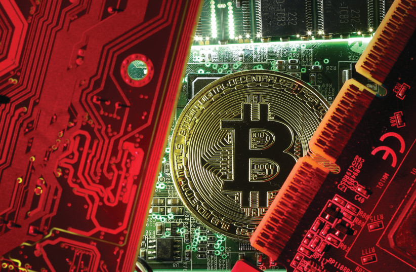 le bitcoin, une nouvelle monnaie virtuelle (photo credit: DADO RUVIC/REUTERS)