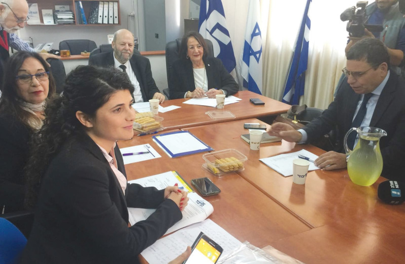 Likud MK Sharren Haskel (left foreground) is taken to task for her opposition to the 'minimarket bill' by an internal faction court in Jerusalem yesterday (photo credit: Courtesy)