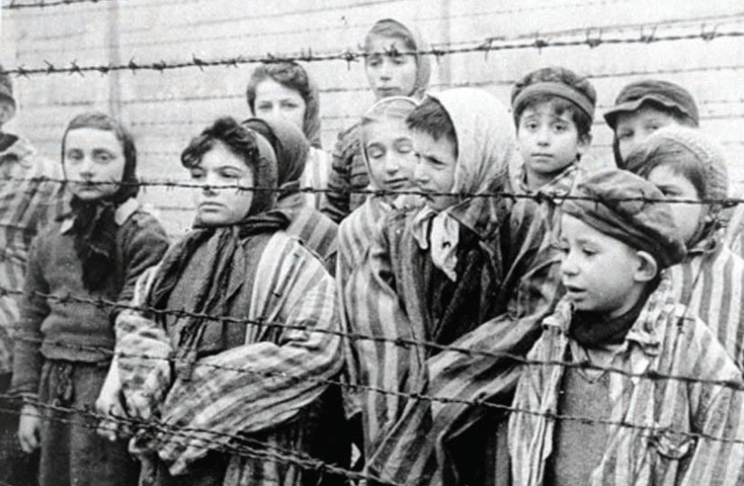 Young survivors of Auschwitz await the arrival of their Soviet liberators on January 7, 1945 (photo credit: Wikimedia Commons)