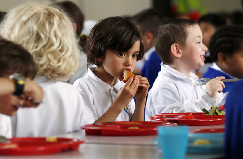 Students eating lunch at school (illustrative) (photo credit: REUTERS)