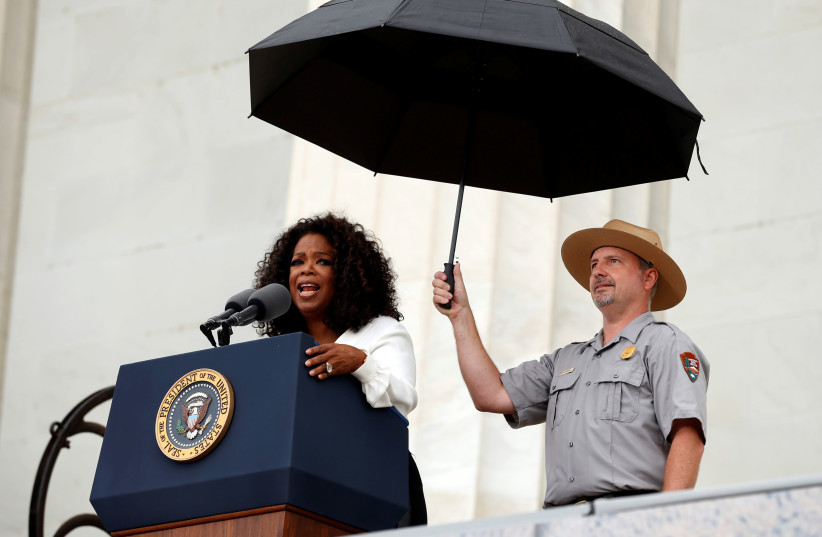 Oprah Winfrey speaks during the commemoration of the 50th anniversary of the March on Washington and Reverend Martin Luther King Jr.'s 'I have a dream' speech at the Lincoln Memorial in Washington, DC. (photo credit: REUTERS)
