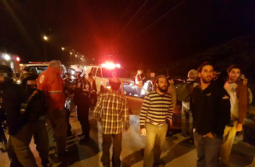 People standing around the scene of a shooting in the West Bank. (photo credit: COURTESY MDA)