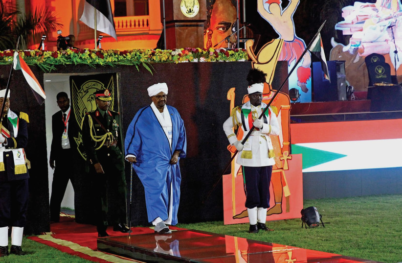 SUDAN'S PRESIDENT Omar Al Bashir arrives to address the nation during its 62nd Independence Day celebrations at the Palace in Khartoum last month. (photo credit: MOHAMED NURELDIN/REUTERS)