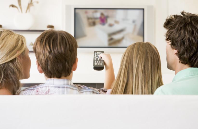 Watching television (Illustrative) (photo credit: INGIMAGE)