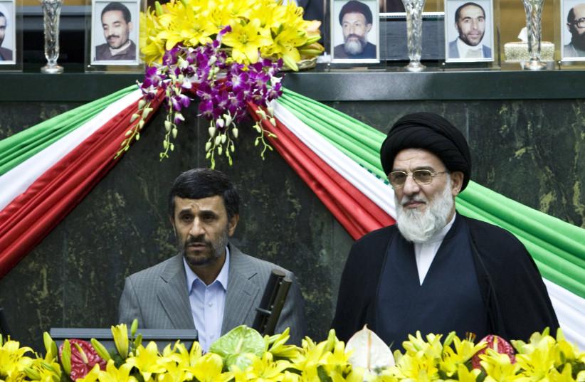 Iran's President Mahmoud Ahmadinejad (L) reads the oath of office as Judiciary Chief Mahmoud Hashemi Shahroudi looks on during Ahmadinejad's swearing-in ceremony in Tehran August 5, 2009. (photo credit: REUTERS)