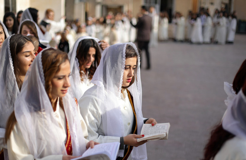 Syriac Christian women pray during mass at the Saint Efram Syriac Orthodox Church in Qamishly, Syria (photo credit: RODI SAID / REUTERS)