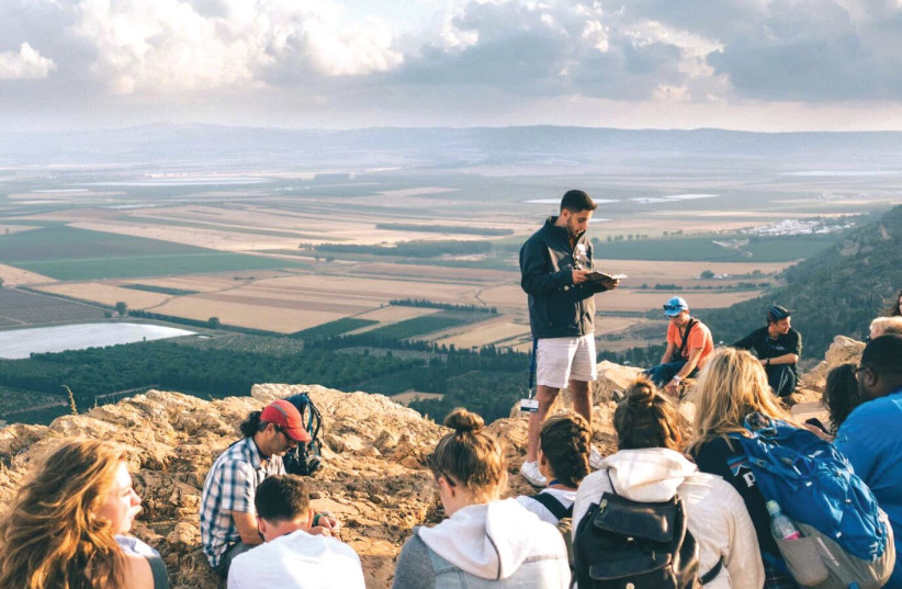 American Christian college students in Israel as part of a program aimed at Christian students, called Passages, visit the holy site of the Mount Precipice in the Galilee town of Nazareth. (photo credit: PASSAGES)