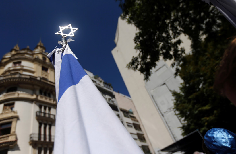 A Star of David is seen outside the former Israeli embassy in Buenos Aires, Argentina at an event to commemorate the 25th anniversy of the building's destruction by a car bomb, March 2017 (photo credit: REUTERS/MARCOS BRINDICCI)