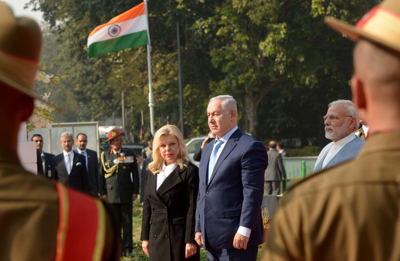 Prime Minister Benjamin Netanyahu and wife Sara at a World War I memorial for Indian soldiers killed in the battle for Haifa, January 14, 2018 (photo credit: AVI OHAYON - GPO)