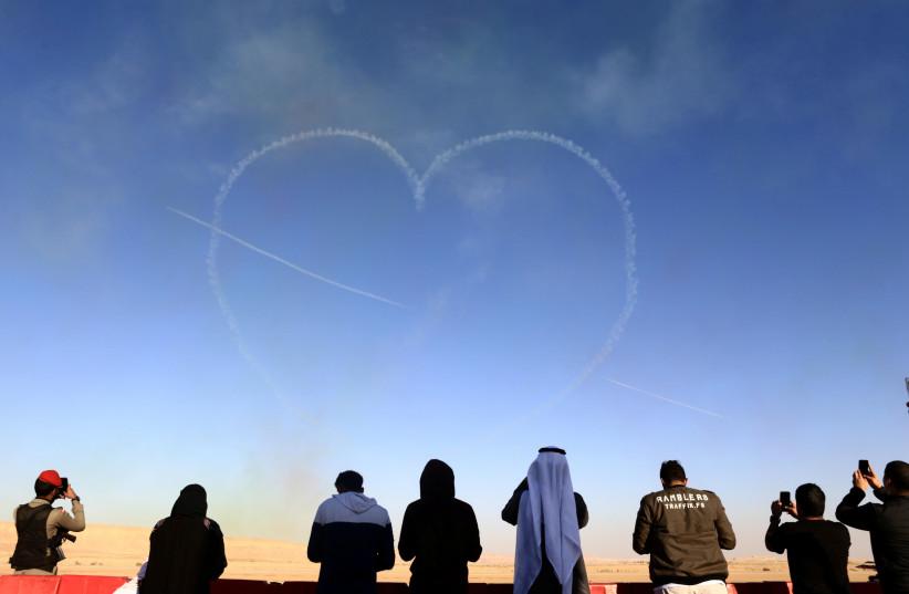 People watch as aircrafts perform during an airshow at Saudi Aviation Forum at Thumamah airport, in Riyadh, Saudi Arabia, January 11, 2018.  (photo credit: FAISAL AL NASSER/ REUTERS)
