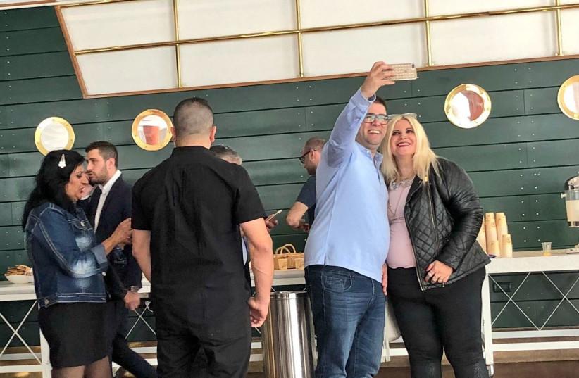 Oren Hazan takes a selfie with an attendee at Likudiada 2018 (photo credit: Lahav Harkov)