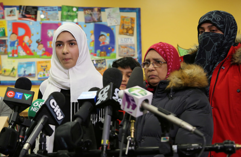 Khawlah Noman, 11, speaks to reporters with her mother at Pauline Johnson Junior Public School, after she told police that a man cut her hijab with scissors in Toronto, Ontario, Canada. (photo credit: REUTERS)
