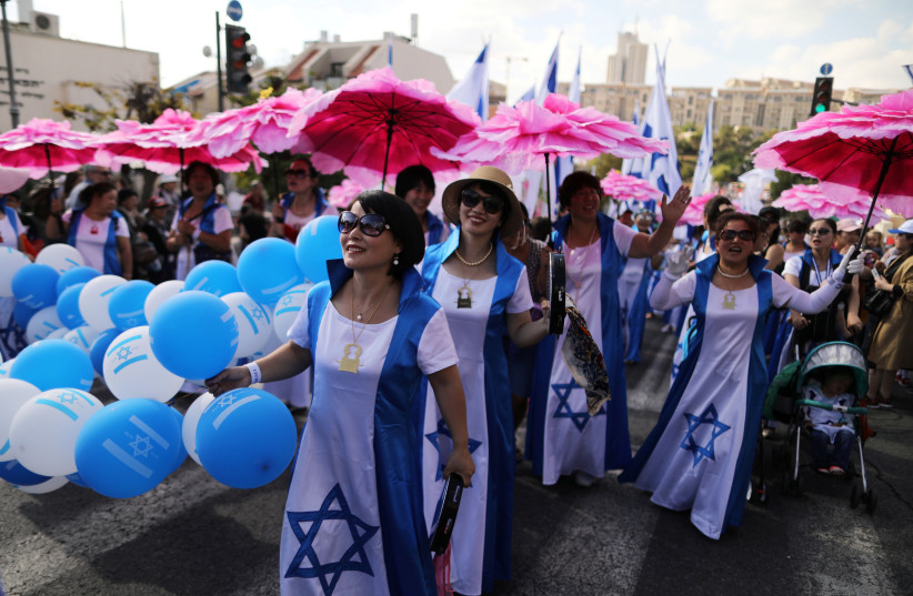 Israelis and foreign nationals participate in the Jerusalem March, an annual pro-Israel procession that takes place in the city during Sukkot, in Jerusalem, in October (photo credit: AMMAR AWAD/REUTERS)