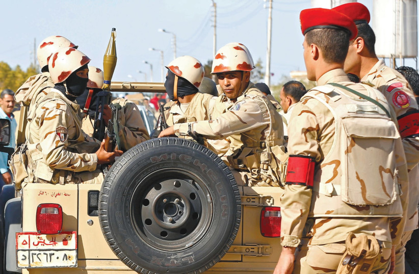 EGYPTIAN MILITARY forces look on in the northern Sinai. (photo credit: MOHAMED ABD EL GHANY/REUTERS)
