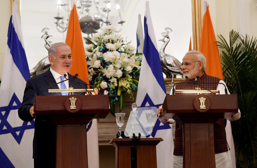 Israeli PM Netanyahu and Indian PM Narendra Modi speak at a press conference in New Delhi. (photo credit: AVI OHAYON - GPO)
