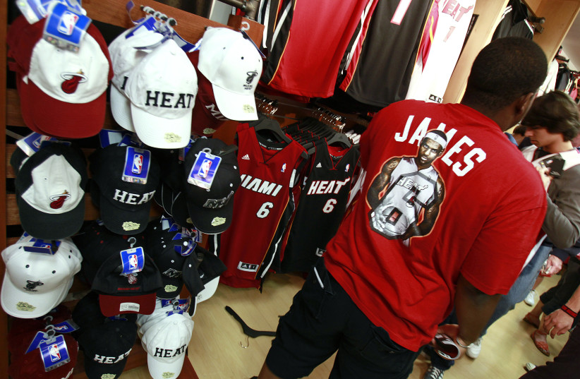 A basketball fan wearing a LeBron James T-shirt at the NBA store in Miami. (photo credit: REUTERS)