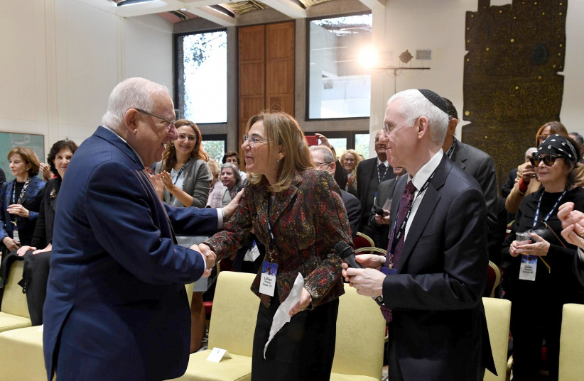 President Reuven Rivlin shakes hands with AIPAC President Lillian Pinkus on January 14th, 2018. (photo credit: Mark Neiman/GPO)
