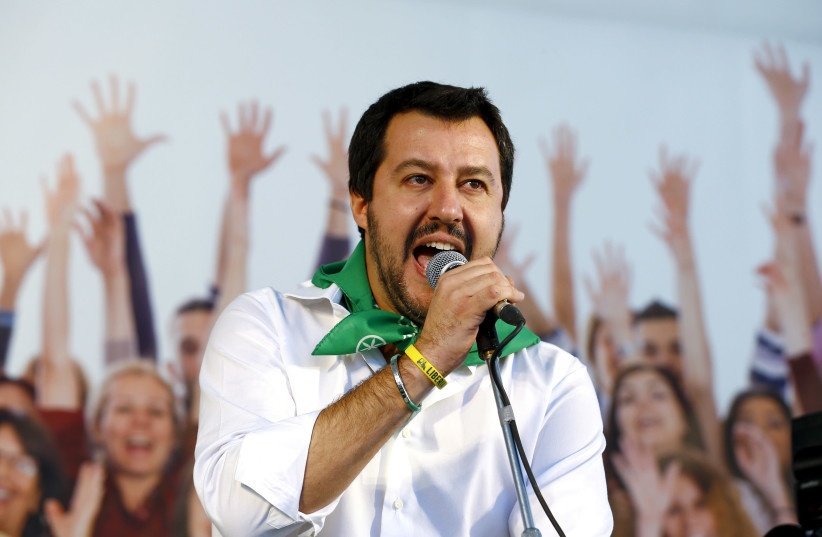 FILE PHOTO: Northern League leader Matteo Salvini speaks during a rally in Bologna, central Italy, November 8, 2015.  (photo credit: STEFANO RELLANDINI/ REUTERS/ FILE PHOTO)