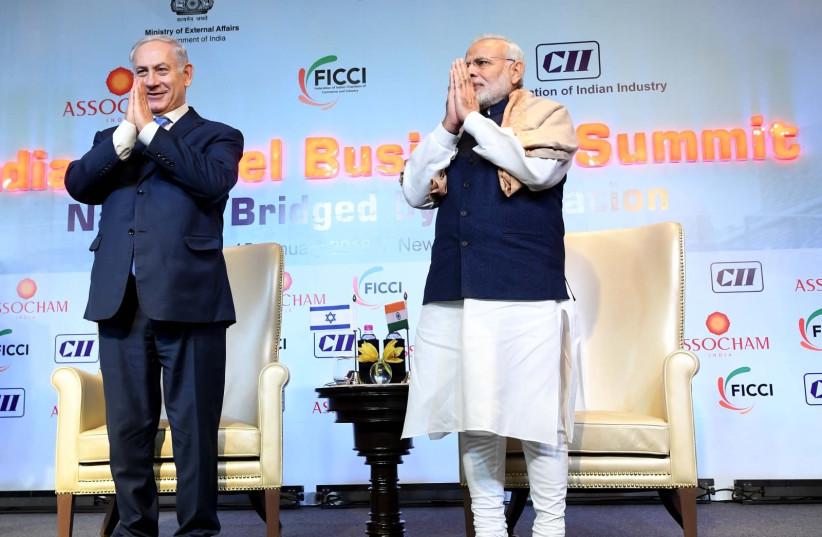 Prime Minister Benjamin Netanyahu and Prime Minister Narendra Modi at the India Israel Business Summit  (photo credit: AVI OHAYON - GPO)