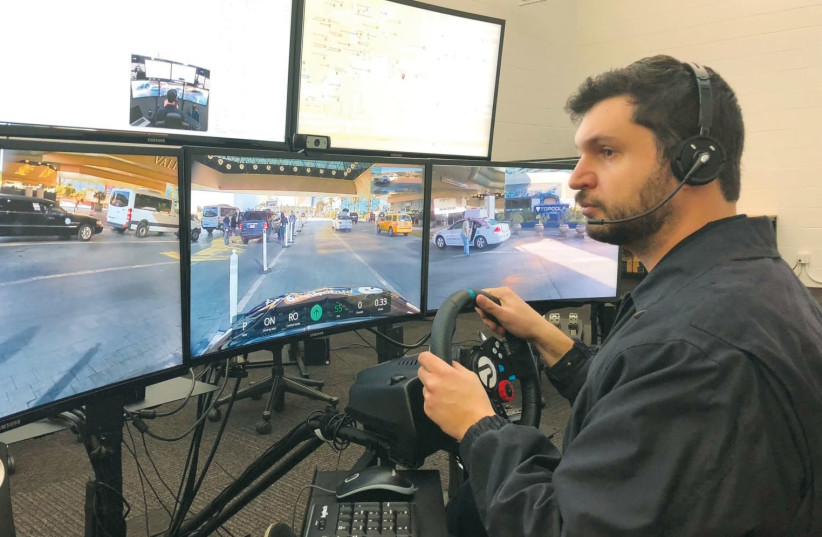 PHANTOM AUTO, one of the Israeli auto-tech companies at CES this year, displayed a system that allows an off-site tele-operator to drive an autonomous vehicle by 'remote control.' (photo credit: Courtesy)
