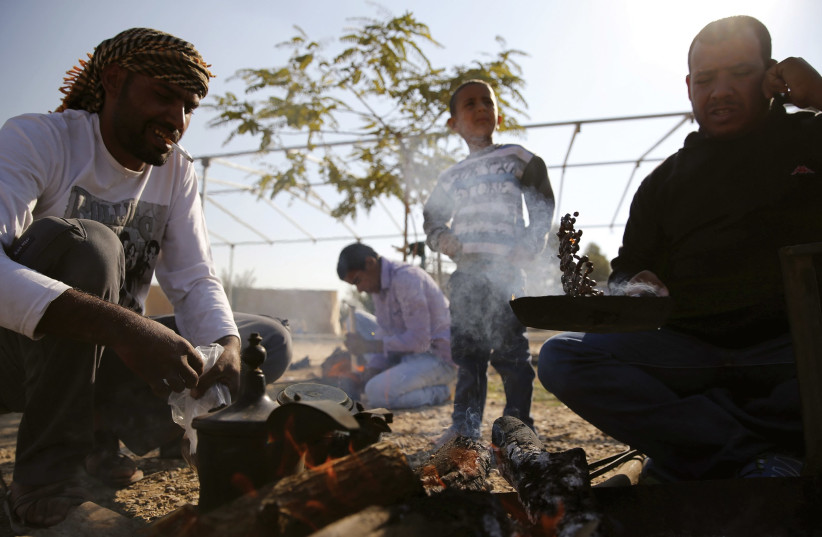 BEDUIN MEN roast coffee beans in a small village near the Beduin town of Rahat in the Negev in December 2015. (photo credit: AMIR COHEN/REUTERS)