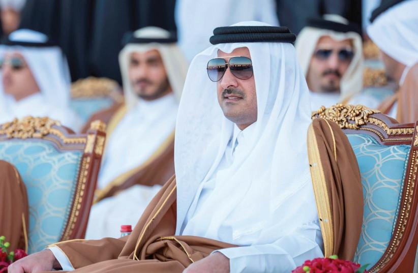 QATAR'S EMIR Sheikh Tamim bin Hamad al-Thani attends Qatar's National Day celebrations in Doha in December. (photo credit: QATAR NEWS AGENCY/HANDOUT VIA REUTERS)
