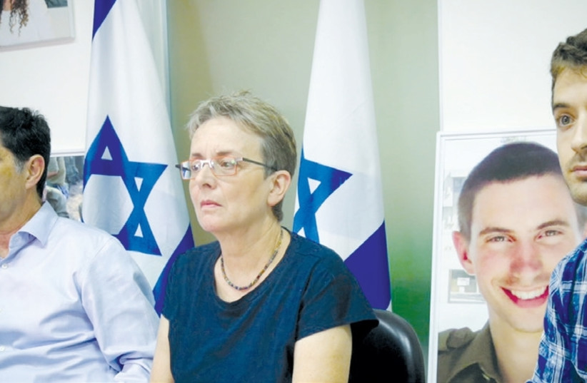 THE PARENTS and twin brother of IDF Lt. Hadar Goldin announce their intent to petition the High Court of Justice to force the government to do more to get Hamas to release the remains of their son. (Flash90) (photo credit: FLASH90)